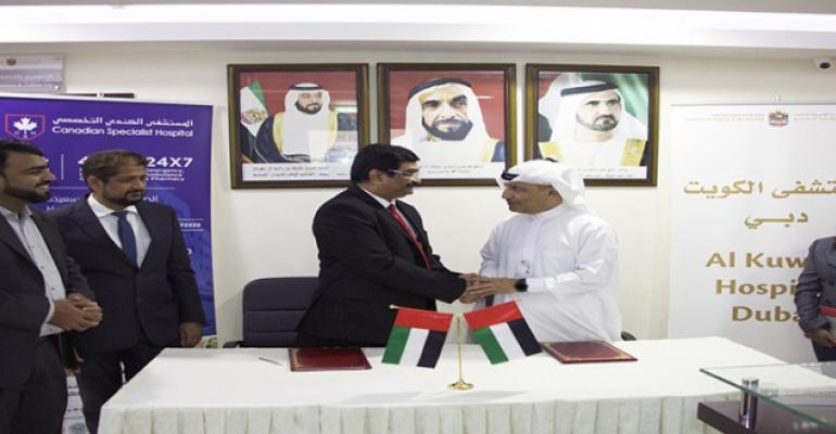 Vivek V Thigale, Chief Operating Officer, Canadian Specialist Hospital and Abdulrazaq Ameri, Director, Al Kuwait Hospital, at the MoU signing