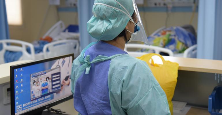 covid-doctor-icu-screen.jpg