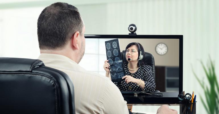 doctor-examines-medical-imaging-scan-in-telemedicine-call.jpg