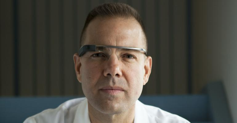 Dr Rafael Grossmann wearing Google Glass