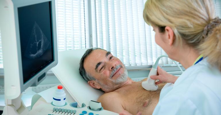 smiling-man-undergoing-ultrasound-on-chest.jpg