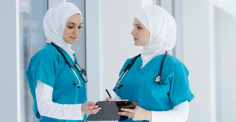 two-middle-eastern-female-doctors-in-conversation.jpg