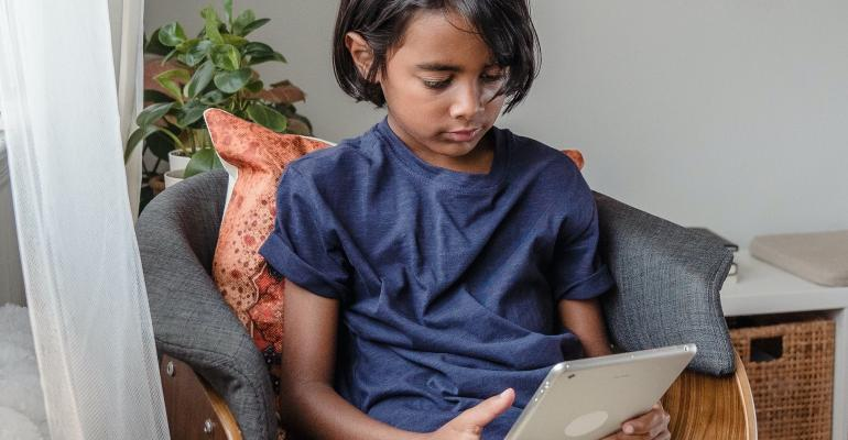 young-child-looking-at-tablet.jpg