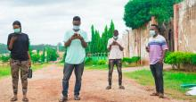 four-young-africans-looking-at-their-smartphone.jpg